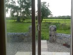 Sliding door to the back of the cottage. Lovely view overlooking fields.