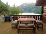 Dining area on upper deck. Seating for 8 people. Weber gas grill. Amazing view of Geiranger fjord