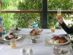 Champagne breakfasts on Dining Deck overlooking the Pool and Bay