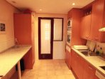 Kitchen with dishwasher, washing machine, microwave and everything you need for your stay.