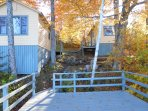 Dock over the water, looking up to Crane and Loon Cottages and picnic table.  Chiminea out of view.