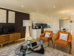 A luxury open space area with kitchen and living room, airy and bright with amazing view over city!