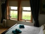 King Size Bed with en-suite looking to country view at from Flat Screen TV WI FI