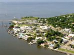 We are located at the base of the bridge in downtown Apalachicola.  First right onto Leslie Street.