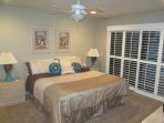 MASTER SUITE WITH KING BED, PRIVATE BATHROOM AND LARGE WALK-IN CLOSET WITH SLIDING DOOR TO PATIO