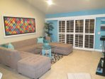 LARGE SECTIONAL IN LIVING ROOM WITH SLIDING DOORS TO PATIO AND AMAZING VIEWS!