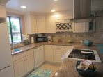 BEAUTIFUL REMODELED KITCHEN-FULLY STOCKED WITH UTENSILS, POTS AND PANS, DISHES, GLASSES, ETC.
