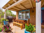 Front patio with seating for 6 and BBQ grill