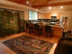 Open Marble Kitchen for Entertaining including Large Counter with Seating.