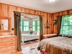 The master bedroom connects to the second bedroom through French doors