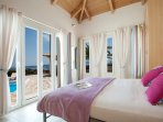 king size bedroom with westerly views