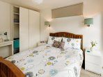 A fresh clean bedroom with king size bed and ample storage space