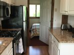 Newly redone kitchen with beautiful granite tops and all you need for a great dining experience.
