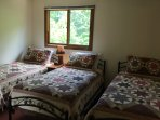 3 twin beds with new beds,  new mattresses and quality quilts and sheets.