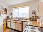 Kitchen with a dishwasher and all details of a home comfort.