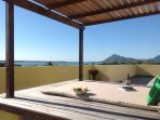 Romantic Ocean & Mountain views from our shared roof terrace