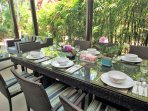 Alfresco dining surrounded by greenery.