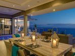Outside dining area overlooking pool and Indian Ocean.
