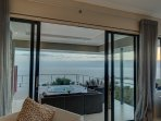 Looking out from the Ocean View Room with Jacuzzi and seating area.