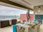 Outside dining area with view of the Indian Ocean.