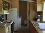 Fully Equipt kitchen: dishes, cookware, toaster, blender, stove, oven, fridge, mixer. Laundry room