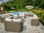 Fire pit with comfortable seating, lovely at night.