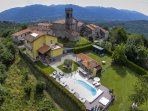 Arial view of the villa its huge garden, the village and mountains.