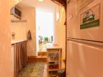 Fully equipped small open Kitchen: 4 electric burners, microwave/oven, washing machine, pots, pans