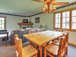 Gather with your loved ones around this handsome dining room table.