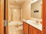 This well equipped bathroom will suffice all your bathing needs.