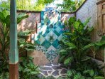 Mermaid: Shower made from Javanese and Egyptian tiles.
