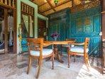 "Villa: The veranda walls are carved panels from a Javanese ""gebiok"" entrance way."