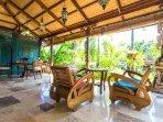 "Villa: Antique Javanese ""sedan"" chairs."