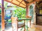 Villa: Side veranda breakfast table, looking into the kitchen.