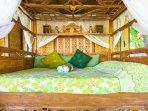 Mermaid: Teak bed carved in Madura Island style.