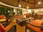 Spacious living room with alang-alang thatched roof for a cool retreat during the heat of the day.