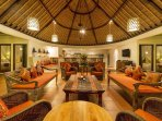 Large living Room overlooking pool under one huge roof ideally designed for the tropics.