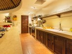 Kitchen with large oven and fridge. Ready to make dinner or a party!