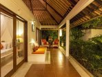 Akasa Villa long cool verandah looks over pool and garden.