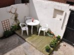 Private yard with decking area/table/chairs