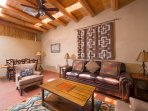 Alternate view of living room with viga ceiling
