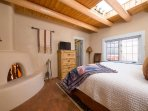 Bedroom with king bed and working, kiva fireplace