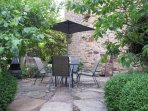Private patio surrounded by shrubs and fruit trees.  Seating for 4 people, with BBQ and chimenea.