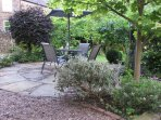 Spacious, private patio at rear of property, looking onto large garden.