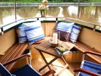 Narrowboat Grouse: Front deck, with seating and table, can be enclosed to form a conservatory.