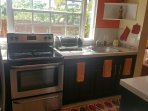 Kitchen with new stove and island to the right