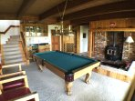 Game  room w/ wetbar, pool table, &sunken conversation pit w/ wood burning stove