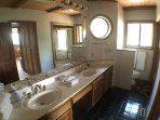 2nd floor bathroom with dual vanities and large soaking tub with shower.