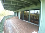 Large lower deck off game room, hot tub, gym, & 2 bedrooms.