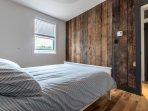 Front bedroom boasts original Pine board walls.